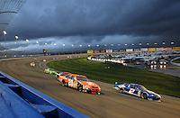 Feb 24, 2008; Fontana, CA, USA; NASCAR Sprint Cup Series driver Tony Stewart (20) races alongside Kurt Busch (2) during the Auto Club 500 at Auto Club Speedway. Mandatory Credit: Mark J. Rebilas-US PRESSWIRE