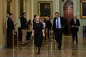 United States Senator Kirsten Gillibrand (Democrat of New York), United States Senator Mark Warner (Democrat of Virginia), and United States Senator Patrick Leahy (Democrat of Vermont) return to the Senate Chamber following a dinner break in the impeachment trial of United States President Donald J. Trump at the United States Capitol in Washington D.C., U.S., on Monday, January 27, 2020.<br />  <br /> Credit: Stefani Reynolds / CNP