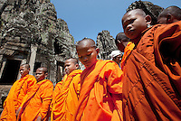 January 17th, 2009_SIEM REAP, CAMBODIA_ A group of young monks enjoy the Bayon Temple, which is a part of Cambodia's Anchor Wat Temple complex, built around 1190 AD by King Jayavarman VII, Bayon is a Buddhist temple but it incorporates elements of Hindu cosmology.  Anchor Wat is a vast complex of temples and other significant structures and is a UNESCO World Heritage site.  Photographer: Daniel J. Groshong/Tayo Photo Group