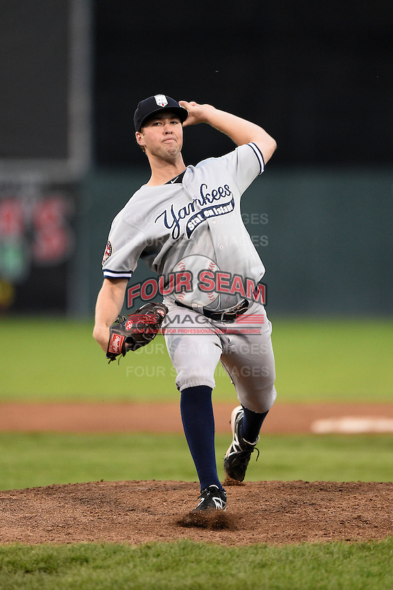 Staten Island Yankees pitcher Ethan Carnes (24) delivers a pitch during a game against the Batavia Muckdogs on August 8, 2014 at Dwyer Stadium in Batavia, New York.  Staten Island defeated Batavia 4-2.  (Mike Janes/Four Seam Images)