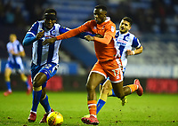Blackpool's Viv Solomon-Otabor vies for possession with Wigan Athletic's Cheyenne Dunkley<br /> <br /> Photographer Richard Martin-Roberts/CameraSport<br /> <br /> The EFL Sky Bet League One - Wigan Athletic v Blackpool - Tuesday 13th February 2018 - DW Stadium - Wigan<br /> <br /> World Copyright &copy; 2018 CameraSport. All rights reserved. 43 Linden Ave. Countesthorpe. Leicester. England. LE8 5PG - Tel: +44 (0) 116 277 4147 - admin@camerasport.com - www.camerasport.com