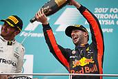 1st October 2017, Sepang, Malaysia;  FIA Formula One World Championship, Grand Prix of Malaysia, 44 Lewis Hamilton (GBR, Mercedes AMG Petronas F1 Team), 3 Daniel Ricciardo (AUS, Red Bull Racing), celebrates on the podium