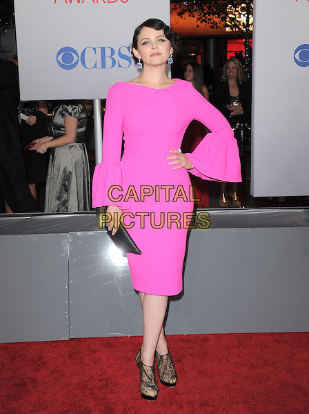 Ginnifer Goodwin.People's Choice Awards 2012 held at Nokia Live in Los Angeles, California, USA..January 11th, 2012.full length dress sleeves cuffs pouffy pink neon fluorescent black clutch bag sheer ankle shoes hand on hip.CAP/RKE/DVS.©DVS/RockinExposures/Capital Pictures.