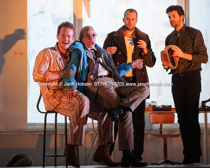 London, UK. 14.10.2015. English National Opera presents, in a co-production with Dutch National Opera, Amsterdam, Puccini's LA BOHEME, at the London Coliseum. Picture shows: Duncan Rock (Marcello), Simon Buteriss (Benoit), Ashley Riches (Schaunard), Zach Borichevsky (Rodolfo).  Photograph © Jane Hobson.