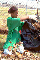 Youth age 10 volunteering at annual Youth Express Dunning Field cleanup.  St Paul  Minnesota USA