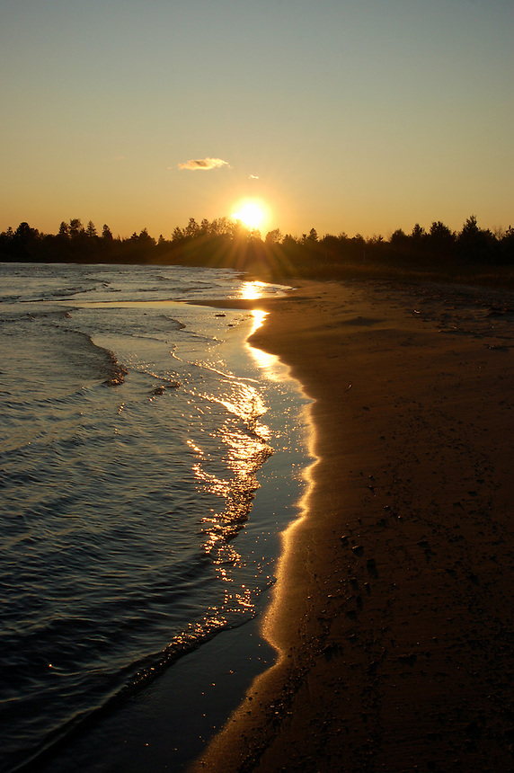 The sun setting the sandy shores of Lake Michigan. Nahma, MI.