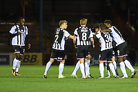 Grimsby Town players celebrates scoring their fourth goal scored by Jon Nolan during the Vanarama National League match between Aldershot Town and Grimsby Town at the EBB Stadium, Aldershot, England on 5 April 2016. Photo by Paul Paxford / PRiME Media Images.