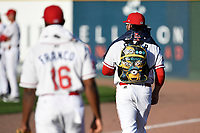 Pitcher Devon Fisher (44) of the Greenville Drive carries the snack and supplies kiddie backpack to the bullpen before a game against the Columbia Fireflies on Tuesday, April 17, 2018, at Fluor Field at the West End in Greenville, South Carolina. Columbia won, 7-5. (Tom Priddy/Four Seam Images)