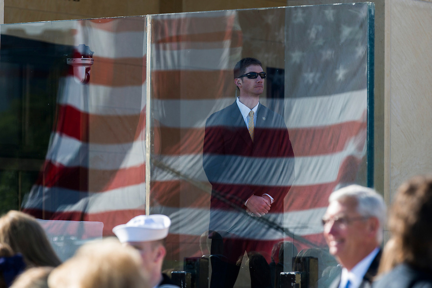 A member of the Secret Service stands watch in front of bullet proof glass at the dedication of the George W. Bush presidential library on the campus of Southern Methodist University in Dallas.