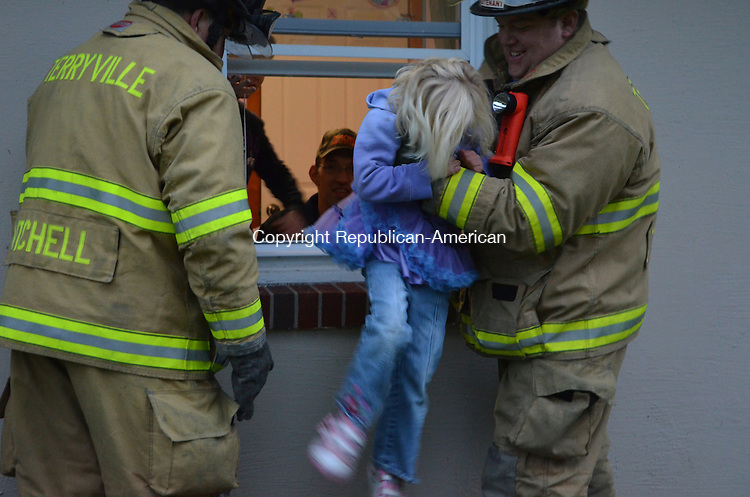 PLYMOUTH, CT-10 October 2013- 101113AG02- Terryville firefighters Victor Mitchell and TJ Zagurski helped Lorelei Telke, 4 of 120 Seymour Road, practice her alternate escape route during Operation E.D.I.T.H., a town-wide fire safety drill.  Alexa Gorman Republican-American