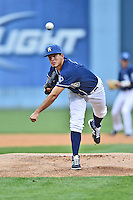 Asheville Tourists starting pitcher Helms Rodriguez (33) warms up before a game against the Greenville Drive on April 16, 2015 in Asheville, North Carolina. The Tourists defeated the Drive 5-4. (Tony Farlow/Four Seam Images)