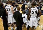 January 14, 2012:   Nevada Wolf Pack coach David Carter, sitting, talks with his team during a time out in their NCAA basketball game against Hawai'i played at Lawlor Events Center on Saturday night in Reno, Nevada.