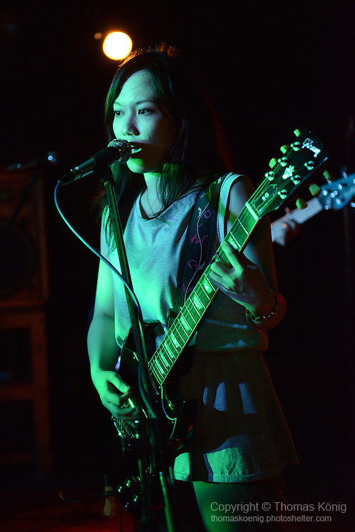 Rocks, Kaohsiung -- Qian-qian(蒨蒨), lead singer of the Kaohsiung-based all-girls band FIND ALICE (尋找愛麗絲), performing on stage.