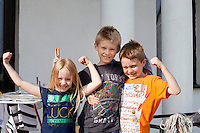 Three happy expressive Polish sibling children. Zawady Central Poland