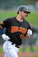 Rochester Red Wings third baseman Trevor Plouffe #16, on rehab from the Minnesota Twins, runs the bases after hitting a home run during a game against the Toledo Mudhens on June 11, 2013 at Frontier Field in Rochester, New York.  Toledo defeated Rochester 9-5.  (Mike Janes/Four Seam Images)