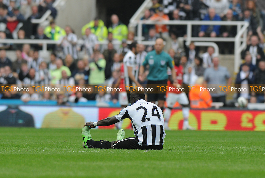 Cheik Ismael Tioté of Newcastle United goes down with cramp - Newcastle United vs Arsenal - Barclays Premier League Football at St James Park, Newcastle upon Tyne - 19/05/13 - MANDATORY CREDIT: Steven White/TGSPHOTO - Self billing applies where appropriate - 0845 094 6026 - contact@tgsphoto.co.uk - NO UNPAID USE