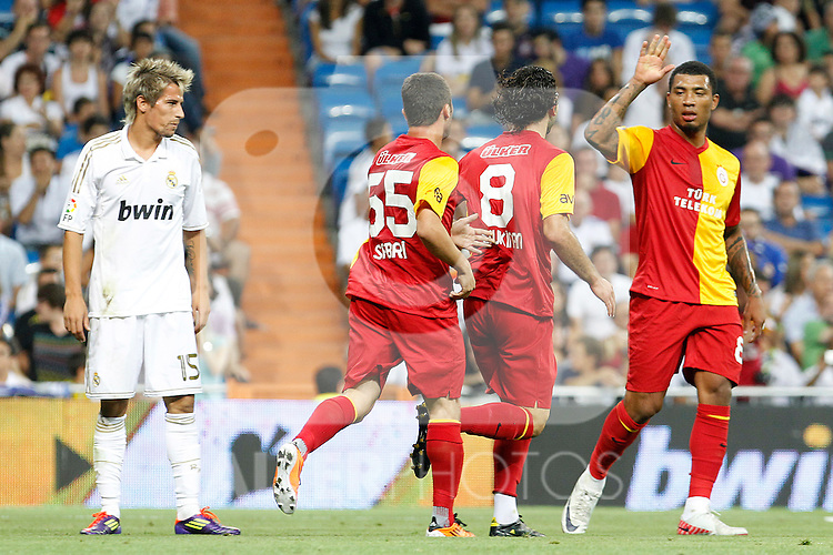Galatasaray's Sabri, Inan and Kazim-Richards celebrates goal in presence of Real Madrid's Fabio Coentrao (l) dejected during Santiago Bernabeu Trophy.August 24,2011. (ALTERPHOTOS/Acero)