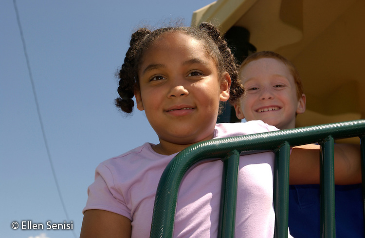 MR/Schenectady, NY.Yates Arts In Education Magnet School.Grade one/ two (split).Girl (6, grade 1, African American and caucasian) and Boy (6, grade 1) on playground at recess..MR: Hic2  Ris 1.©Ellen B. Senisi