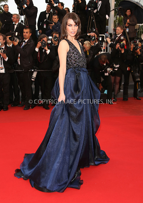 WWW.ACEPIXS.COM....US Sales Only....May 22 2013, Cannes....Milla Jovovich at the premiere of 'All Is Lost' during the 66th Cannes Film Festival on May 22 2013 in France ....By Line: Famous/ACE Pictures......ACE Pictures, Inc...tel: 646 769 0430..Email: info@acepixs.com..www.acepixs.com