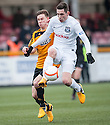 Ayr Utd's Kyle McAusland stops Alloa's Mitchel Megginson.