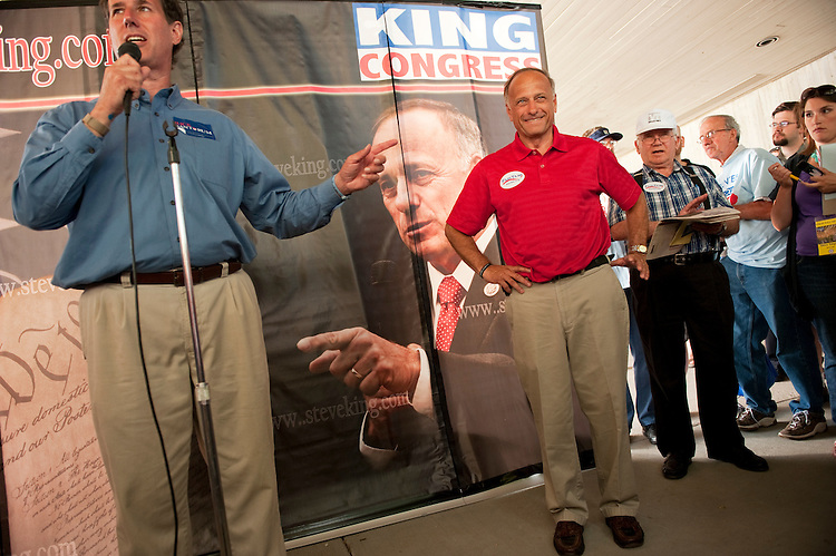 UNITED STATES - AUGUST 13:  Rep. Steve King, R-Iowa, listens to Republican presidential candidate Rick Santorum, address a crowd at the Ames Straw Poll at Iowa State University in Ames, Iowa.  (Photo By Tom Williams/Roll Call)