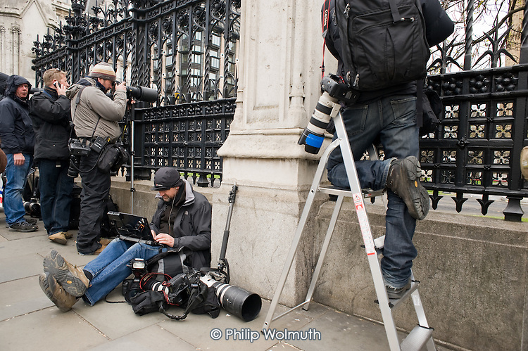 Press photographers wait outside the Houses of Parliament as politicians from the three main parties negotiate following an indecisive result in the 2010 General Election.