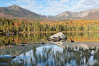 Maine's Mt. Katahdin, located in Baxter State Park, is shown here reflected in Sandy Stream Pond at the height of Autumn color.