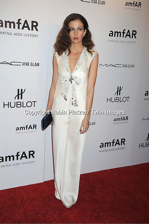 arrives at the amfAR New York Gala to kick off Fashion Week on February 8, 2012 at Cipriani Wall Street in New York City.
