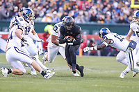 Philadelphia, PA - December 8, 2018:  Army Black Knights quarterback Kelvin Hopkins Jr. (8) gets tackled by several Navy Midshipmen defenders during the 119th game between Army vs Navy at Lincoln Financial Field in Philadelphia, PA. (Photo by Elliott Brown/Media Images International)