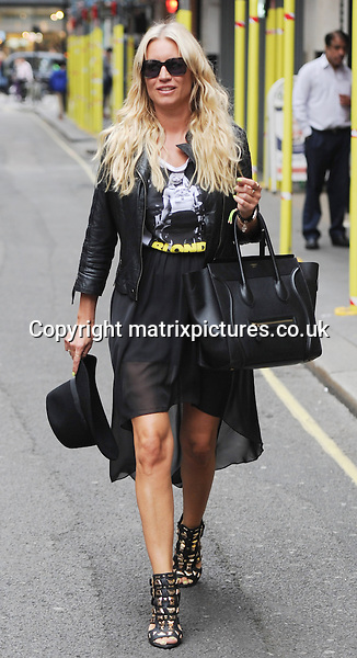 EXCLUSIVE PICTURE: PALACE LEE / MATRIXPICTURES.CO.UK<br /> PLEASE CREDIT ALL USES<br /> <br /> WORLD RIGHTS<br /> <br /> English actress, singer and TV presenter Denise Van Outen is spotted leaving Magic FM in London. <br /> <br /> JULY 5th 2014<br /> <br /> REF: LTN 143191