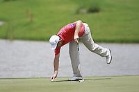 Padraig Harrington (IRL) repairs his pitch mark on the 18th green during Sundays Final Round 3 of the 54 hole Iskandar Johor Open 2011 at the Horizon Hills Golf Resort Johor, Malaysia, 19th November 2011 (Photo Eoin Clarke/www.golffile.ie)
