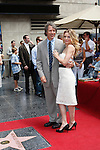 Michelle Pfeiffer  and husband David E Kelley.Michelle Pfeiffer receives a star on the Hollywood of Fame at Hollywood & Highland on August 6, 2007.  .Photo by Nina Prommer/Milestone Photo