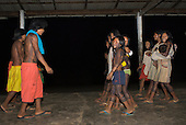 Pará State, Brazil. Aldeia Pukararankre (Kayapo). The boys and girls dancing in the evening.