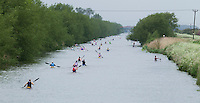 25 MAY 2014 - BRIGG, GBR - Competitors paddle their kayaks along the River Ancholme to the turn as race leader Steve King (right) makes his way back to transition during the World Quadrathlon Federation 2014 Middle Distance World Championships at the Brigg Bomber in Brigg, Lincolnshire, Great Britain (PHOTO COPYRIGHT © 2014 NIGEL FARROW, ALL RIGHTS RESERVED)