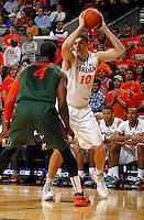 Virginia forward/center Mike Tobey (10) handles the ball next to Miami forward Raphael Akpejiori (4) during an NCAA basketball game Saturday Feb, 24, 2014 in Charlottesville, VA. Virginia defeated Miami 65-40.