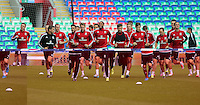 CARDIFF, WALES - SEPTEMBER 05: Team captain Ashley Williams (C) warms up with team mates during the Wales training session, ahead of the UEFA Euro 2016 qualifier against Israel, at the Cardiff City Stadium on September 5, 2015 in Cardiff, Wales.