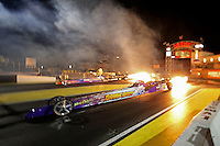 Apr. 5, 2013; Las Vegas, NV, USA: (Editors note: A special effects lens used in creation of this image) A pair of NHRA jet car drivers shoot flames out of theirs exhausts prior to racing during qualifying for the Summitracing.com Nationals at the Strip at Las Vegas Motor Speedway. Mandatory Credit: Mark J. Rebilas-