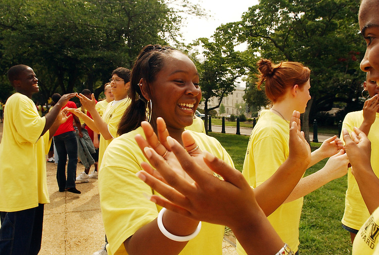 "Jazmyne Straughter, 15, plays a clapping game called ""slide"" with other members of the West Virginia State University Upward Bound program, while waiting to board their bus.  Upward Bound is a college prepartion program for low income students,"