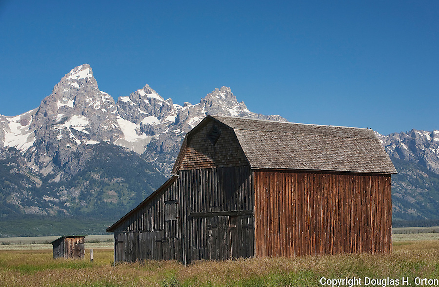 Remains of a historic Barn along Mormon Row frame the Teton Range.  Grand Teton National Park, United States, Wyoming.  Mormon Row is a line of historic homesteads along Jackson-Moran Road, Grand Teton National Park.