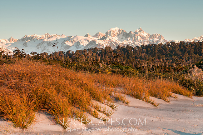 View of Mt. Tasman 3497m and Mt. Cook 3754m from Three Mile Lagoon Beach during sunset, Westland National Park, West Coast, UNESCO World Heritage Area, New Zealand