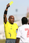 11 November 2008: Referee Noel Cotterell shows a yellow card to NC State's Ronnie Bouemboue (7). North Carolina State University Wolfpack defeated the Virginia Tech Hokies 3-1 at Koka Booth Stadium at WakeMed Soccer Park in Cary, NC in a men's ACC tournament first round game.