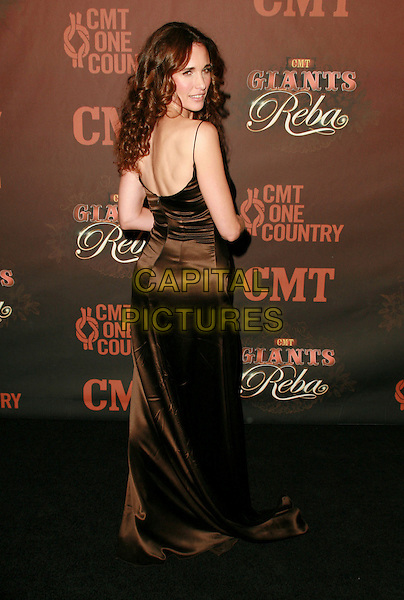 ANDIE MacDOWELL.At CMT Giants honoring Reba McEntire held at the Kodak Theatre, Hollywood, LA, California, USA.26 October 2006..full length back rear behind brown dress andy mcdowell.Ref: ADM/CH.www.capitalpictures.com.sales@capitalpictures.com.©Charles Harris/AdMedia/Capital Pictures.