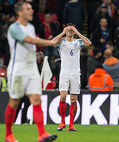 John Stones (Man City) of England holds his head as England concede a second goal during the International Friendly match between England and Spain at Wembley Stadium, London, England on 15 November 2016. Photo by Andy Rowland.