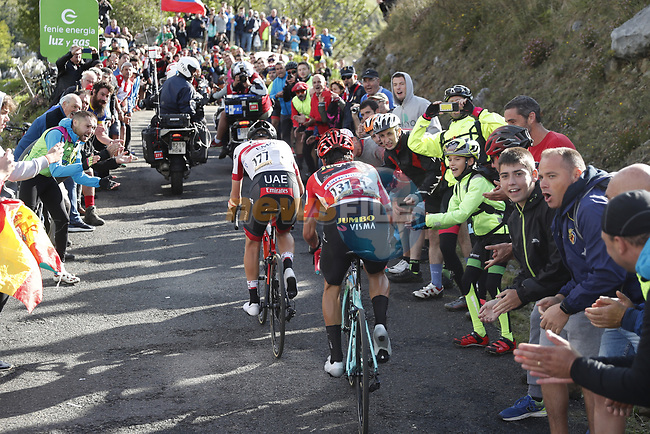 Countrymen Tadej Pogacar (SLO) UAE Team Emirates and race leader Red Jersey Primoz Roglic (SLO) Team Jumbo-Visma attack on the final climb of Stage 13 of La Vuelta 2019 running 166.4km from Bilbao to Los Machucos, Spain. 6th September 2019.<br /> Picture: Luis Angel Gomez/Photogomezsport | Cyclefile<br /> <br /> All photos usage must carry mandatory copyright credit (© Cyclefile | Luis Angel Gomez/Photogomezsport)