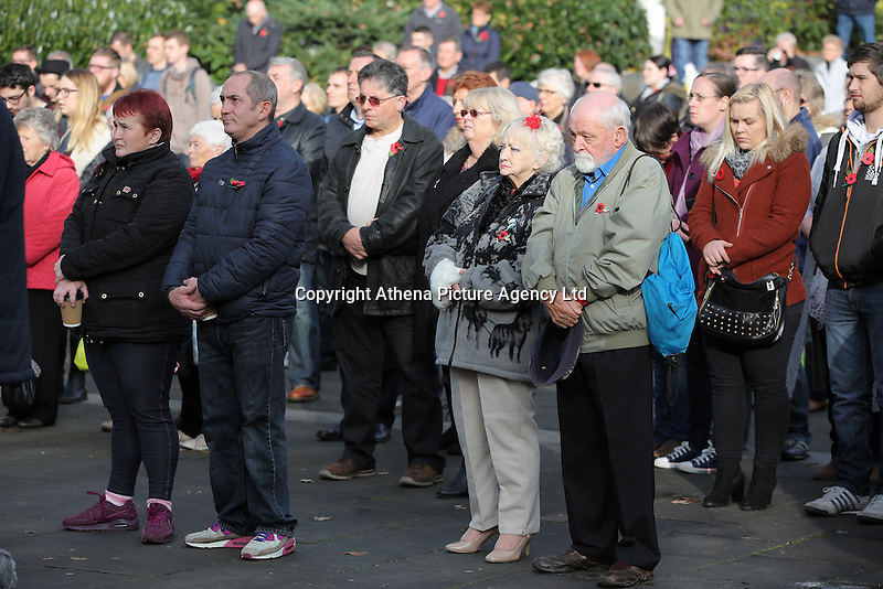 Pictured: People of all ages and background observe the minute's silence Friday 11 November 2016<br />