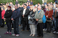 Pictured: People of all ages and background observe the minute's silence Friday 11 November 2016<br />Re: Remembrance Day service at Castle Square Gardens in Swansea, south Wales, UK.