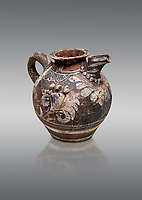 Minoan Kamares Ware ewer jug with polychrome decorations , Phaistos 1800-1700 BC; Heraklion Archaeological  Museum, grey background.<br /> <br /> This style of pottery is named afetr Kamares cave where this style of pottery was first found