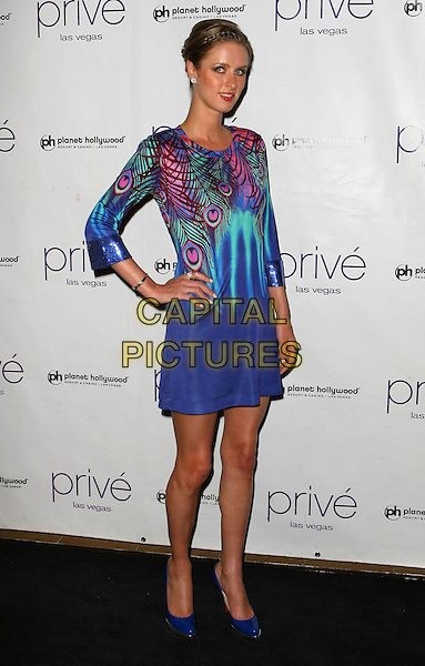 NICKY HILTON.Nicky Hilton hosts a night at Prive' Nightclub at the Planet Hollywood Resort Hotel and Casino, Las Vegas, Nevada, USA..April 11th, 2009.full length purple blue pink green dress sleeves peacock feather pattern hand on hip .CAP/ADM/MJT.© MJT/AdMedia/Capital Pictures.