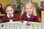 Junior Infant pupils Ciara Ní Chínneide and Hayley Ní Fhlaithearta from Scoil an Ghleanna on their first day at school on Monday morning.