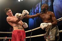 Derrick Osaze (grey shorts) defeats Kieran Conway during Ultimate Boxxer III at Indigo at the O2 London on 10th May 2019
